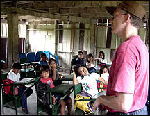 Creative Connections Project Director working with students in the Amazon Rain Forest.
