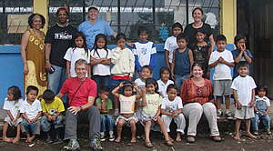 OneWorld Classrooms volunteers with students at the Puyopungo Elementary School.